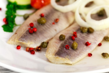 Young Herring with Onion , Potato ,Red Peppers  Stock Photo - 10037584