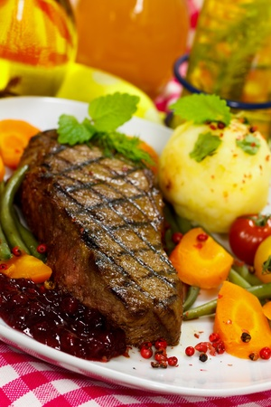 Gourmet Steak with Cherry Tomato,Carrots,Green Beans photo