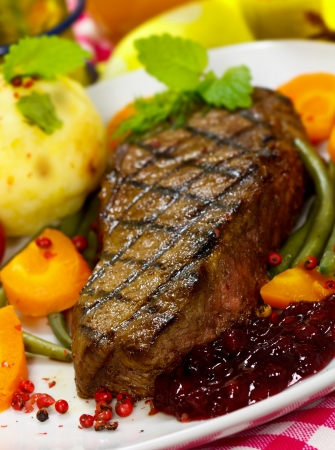 new york strip: Gourmet Steak with Green Beans,Potato,Cranberry,Carrot  Stock Photo