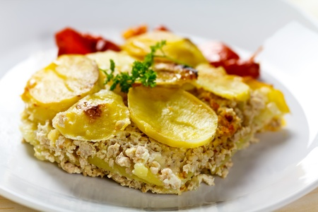 baked moussaka dish on a wooden board  photo