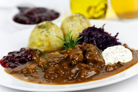 goulash: Gourmet Venison goulash with potato dumplings and garnish