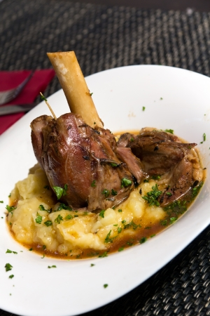 rack of lamb: Braised lamb shank in mint and rosemary gravy, with Puree Stock Photo