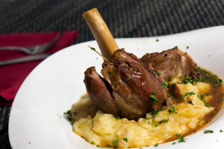 Braised lamb shank in mint and rosemary gravy, with Puree Stock Photo