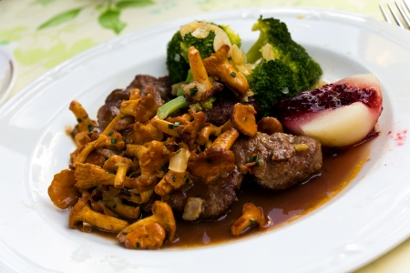 chanterelle: Tenderloin of Roe Deer Back with Chanterelle Stock Photo