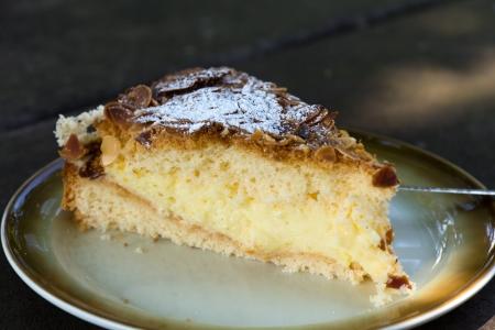 Slice of lemon meringue pie with almonds, selective focus  photo