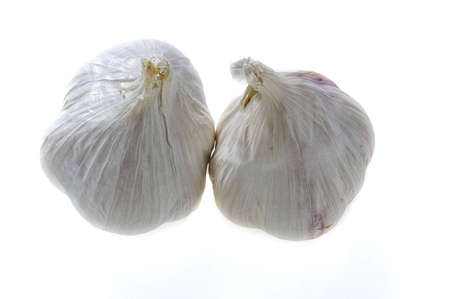 Two garlic bulbs - isolated on white