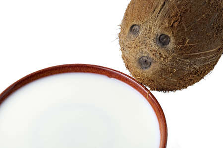 Coconut  with face drinking milk from a saucer Stock Photo