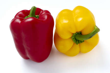 Red and yellow peppers isolated on white Stock Photo