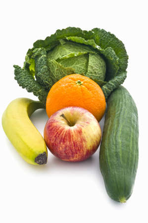 Apple, banana, cumcumber, orange, cabbage representing five fruits and vegtables recommended each day for a healthy lifestyle Stock Photo - 9283700