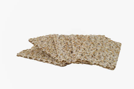 Seasame seed, rye crispbread isolated on white. Clipping path
