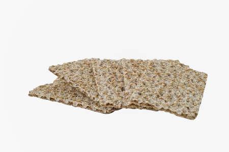 Seasame zaad, rogge knäckebröd geïsoleerd op wit. Het knippen weg Stockfoto