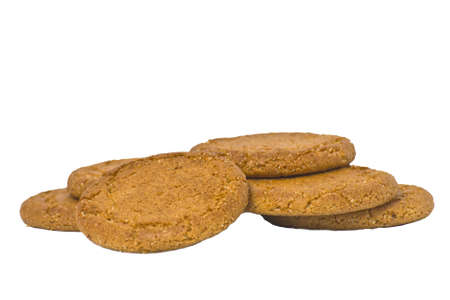A Pile of Ginger biscuits isolated on white.