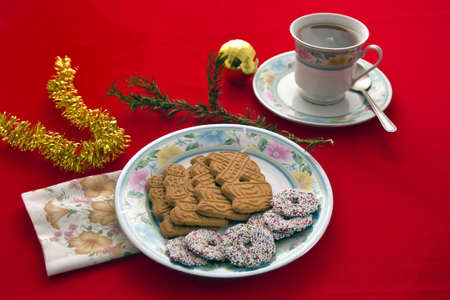 Spiced Christmas biscuits with drink in cyp and saucer.  Stock Photo