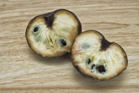 Cut custard apple on cutting board  Also known as Bullocks or Bulls heart