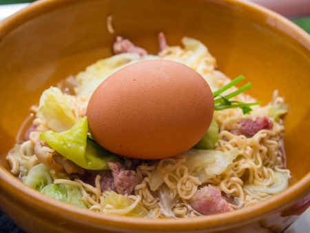 boiler suit: Boiled of the Instant noodles with Boiled eggs that are not peeled.Focus on the egg. Stock Photo