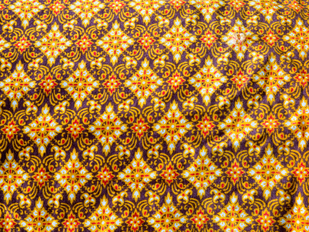Close Up of gold fabric delicate at Thailand stripes pattern background.