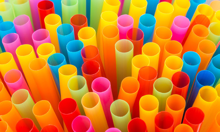 orange color: Closeup of Colorful drinking straws background. Stock Photo