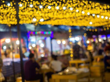 Bangkok walk market light night cityscape at twilight time, abstract blurred Photo bokeh, yellow background.