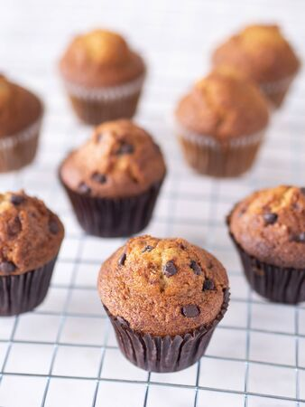Top view close up brown muffin or banana cake on white table background for breakfast in morning day.