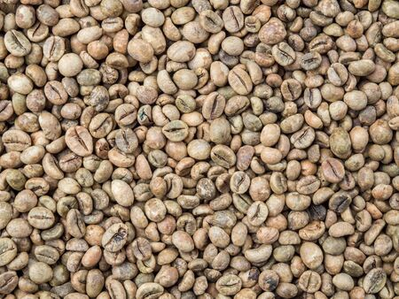 Close up raw coffee bean organic pile nature  background, top view Stock Photo