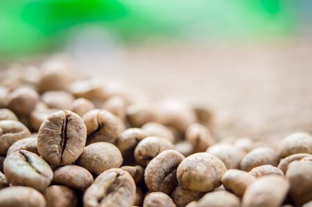 Close up raw coffee bean organic pile nature  background.
