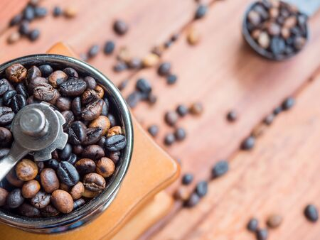 Close up coffee beans organic in wooden grinder homemade on wood table background, top view Stok Fotoğraf