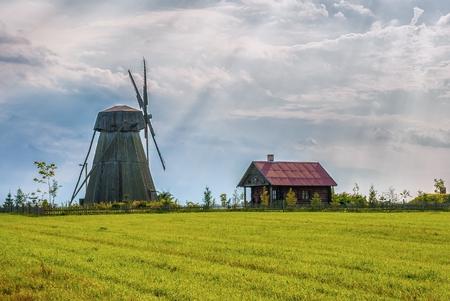 old historic windmill at sunset