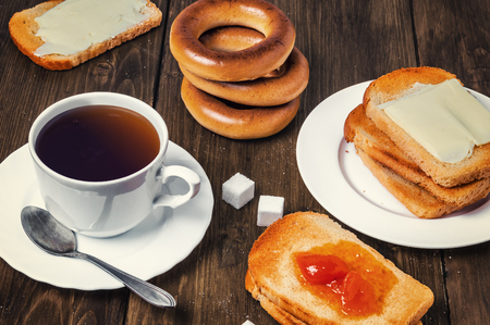 bread and butter: Healthy breakfast with cup of tea, bread, butter and jam Stock Photo
