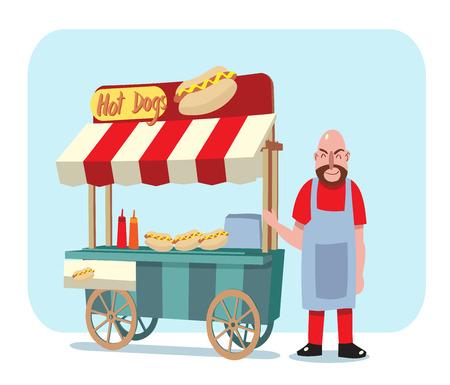 販売男と通りカートのホットドッグ