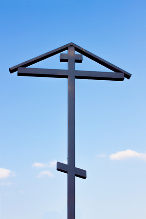 christian crosses: View on the christian cross with sky Stock Photo