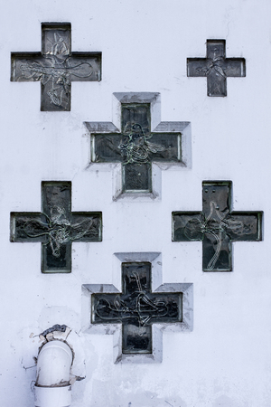 christian crosses: Wall of church with glass christian crosses Stock Photo
