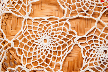 doily: Handmade beige lace doily on the table