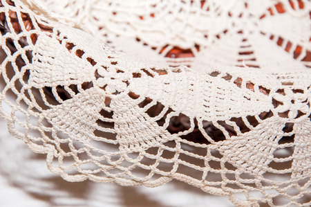 lace doily: Handmade beige lace doily on the table