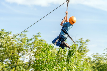 Child is climbing in the rope park