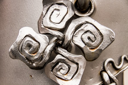 macroshot: A macroshot of shiny metal floral ornament