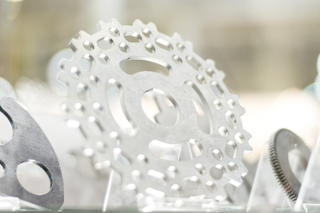 machined: Industrial machined part: gears, details and cogwheel