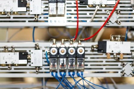 Modern and hi-tech microcontrollers for pneumatic pistons Stockfoto