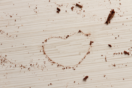 pices: Heart shape from pices of black chocolate on wood background for valentines day