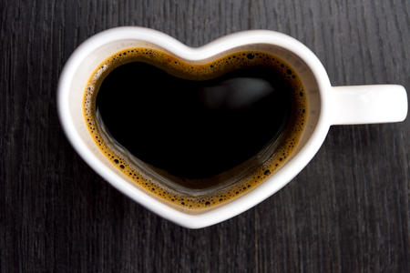 valentine day cup of coffee: Cup with coffee shaped heart i love you on wood background Stock Photo