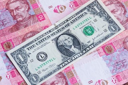 depreciation: Hryvnia depreciation concept. One american dollar over ukrainian money