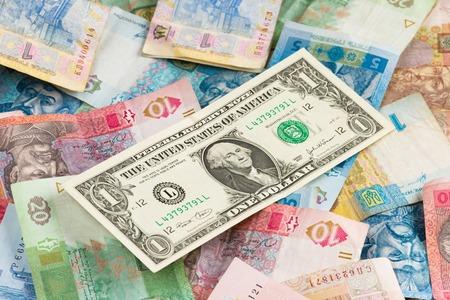 economic recovery: Currency exhange concept. American one dollar on ukrainian money background Stock Photo