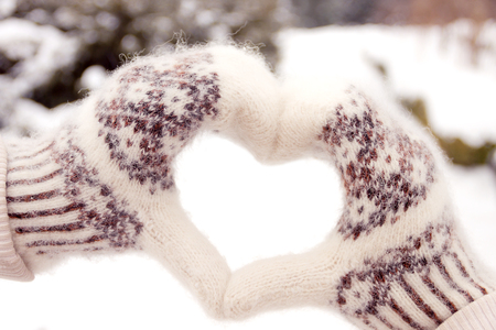 love hands: Couple in love making heart shape from hands in winter