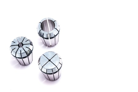 collet: Metal collets for instruments for heavy industry on white background Stock Photo