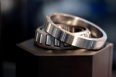 bearing: ?ylindrical bearing with bokeh background Stock Photo