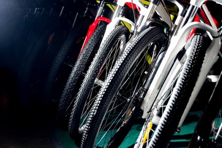 treads: Row of multi-colored bikes, tyres, absorbs,