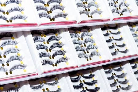 Beautiful false eyelashes. Row of long false eyelashes.
