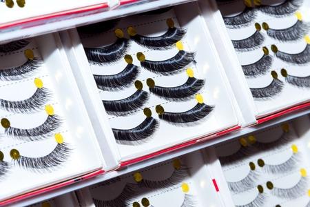 Line of long false eyelashes. Professional make-up. Eyelashes styling Stock Photo