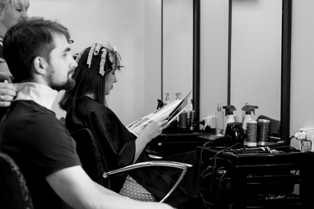 hair cutting: Man in hair doing salon. Black and white view. Waiting for hair cutting