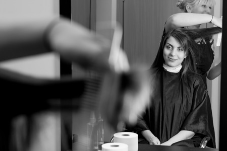 hair cutting: Professional hair cutting. Beautiful girl in professional barber salon. New hair look Stock Photo