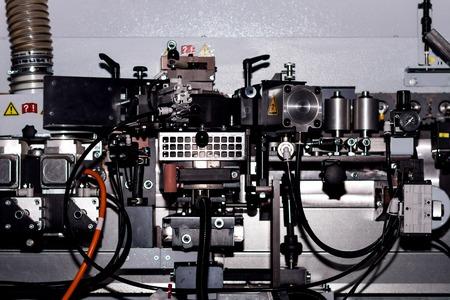 Pneumatic hydraulic control system of woodworking machine